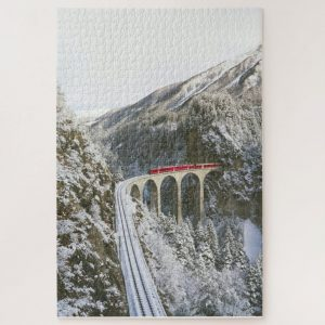 Red Train amongst Snowy Mountains – 1000 piece jigsaw puzzle